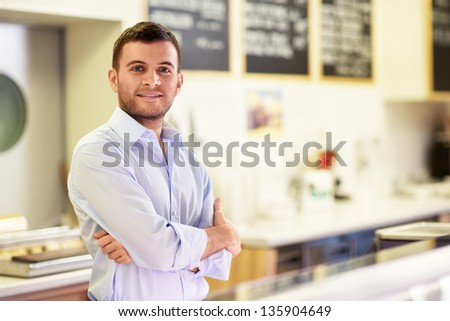 Young man at the counter - stock photo