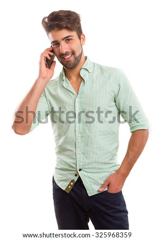 Young man at the phone, isolated over white background - stock photo