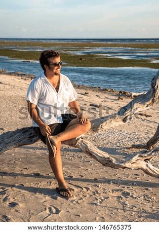 Young man at vacations - stock photo