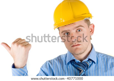 Young man at yellow helmet and hand sign isolated on white
