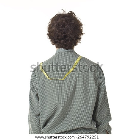Young Man Back Portrait With Measuring Tape. - stock photo