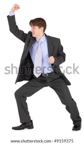 Young man beats his fist isolated on a white background