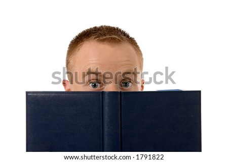 young man behind a book