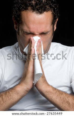 Young Man Blowing Nose - stock photo
