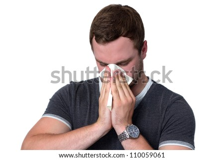 Young Man Blowing Nose into a tissue - stock photo