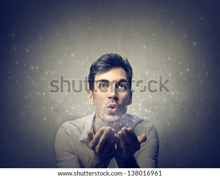 young man blows - stock photo