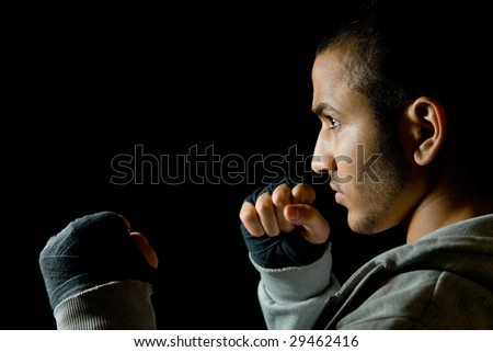 Young man boxing at night - stock photo
