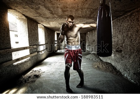 Young man boxing workout in an old building - stock photo