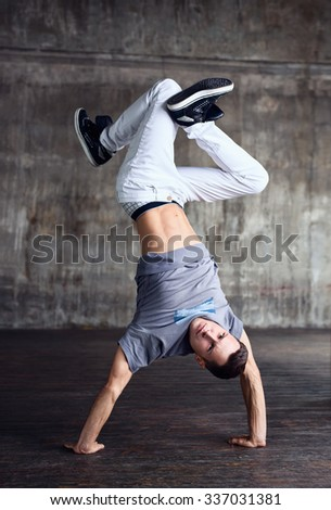 Young man break dancing urban interior - stock photo