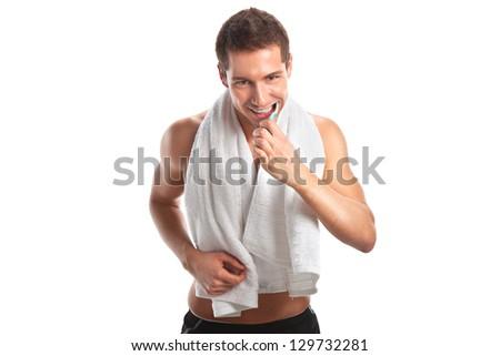 Young man brushing his teeth / Man brushing teeth isolated on white - stock photo