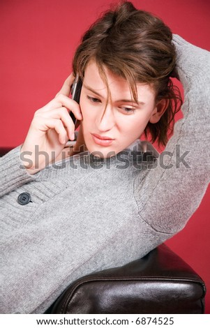 young man calling by cellular phone - stock photo