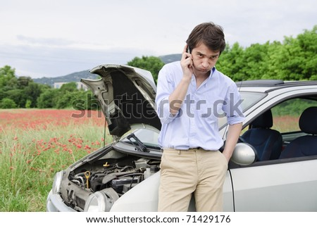young man calling for car service - stock photo