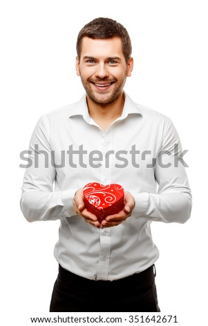 Young man carries a lot of presents, isolated on white - stock photo