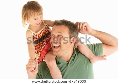 Young man carries child on shoulders