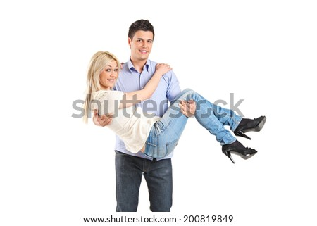 Young man carrying his girlfriend isolated on white background - stock photo