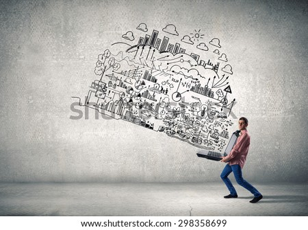 Young man carrying his great business plan in hands - stock photo