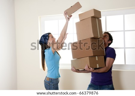 Young man carrying stacked boxes