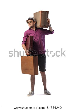Young man carrying two big suitcases - stock photo