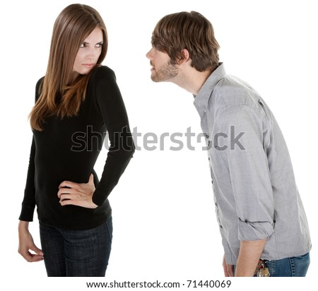 Young man Caucasian trying to win back his unhappy girlfriend - stock photo