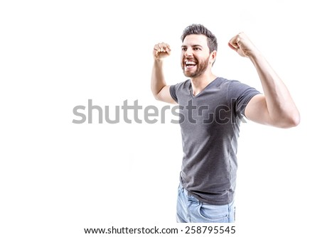 Young man celebrating on white background
