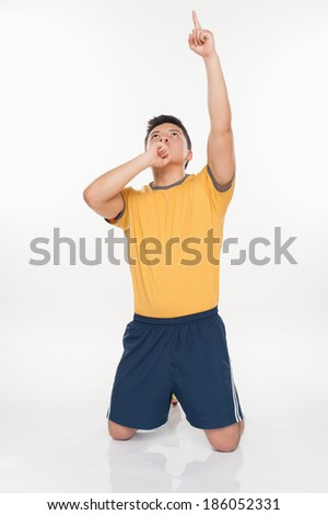Young man celebrating soccer goal