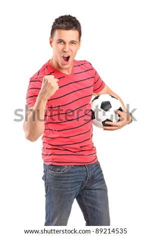 Young man cheering and holding a football on white background - stock photo