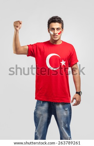 Young man cheering on white background - stock photo