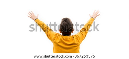young man cheering open arms at mountain with fog - stock photo