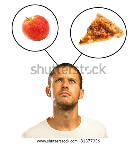 young man choosing between pizza and apple on a white background - stock photo