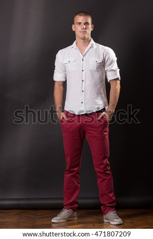 Young man classic posing standing 20 years old pants shirt casual