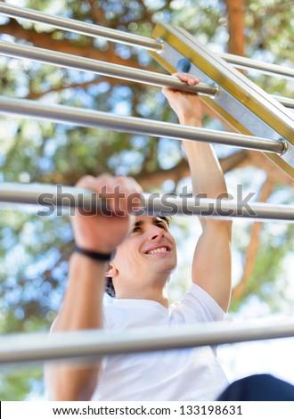 Young Man Climbing And Exercising Outdoors - stock photo