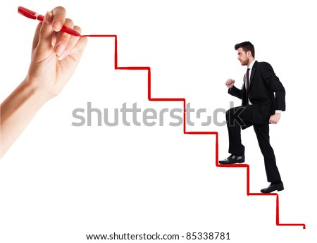 Young man climbs the ladder of success - stock photo