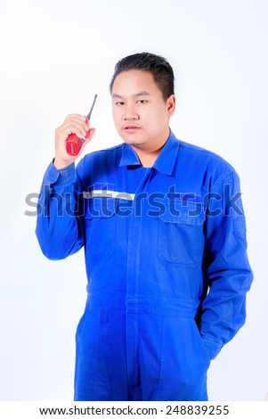 young man communicating on walkie-talkie isolated white background.
