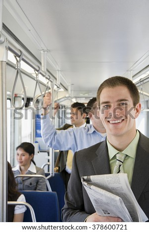 Young man commuting - stock photo