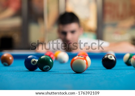 Young Man Concentration On Ball - Portrait Of A Young Man