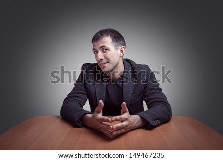 Young man conducts business negotiations - stock photo