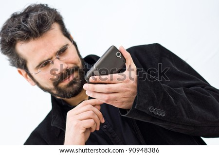 Young man consulting his mobile phone against white background