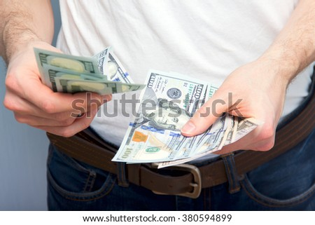 Young man counting cash