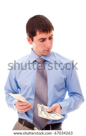 young man counts the money - stock photo