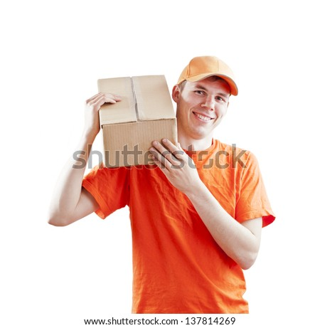 Young man courier in orange holding on the shoulder a box isolated on white - stock photo