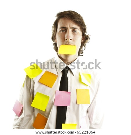 young man covered by notes - stock photo
