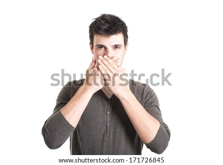 Young man covering his mouth with hands on a white background - stock photo