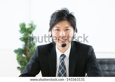 young man customer service operator - stock photo