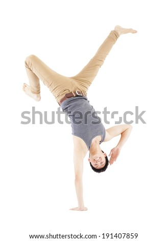 Young man dancing a breakdancing  and handstand pose