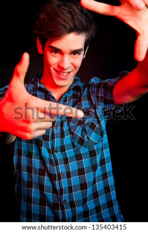 Young man dancing and enjoying music at disco - stock photo