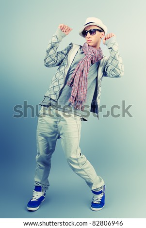 Young man dancing hip-hop at studio.