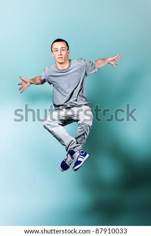 Young man dancing hip-hop at studio. - stock photo