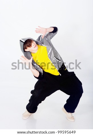 Young man dancing in studio