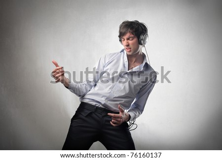 Young man dancing to the music - stock photo