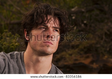 Young man deep in thought - stock photo